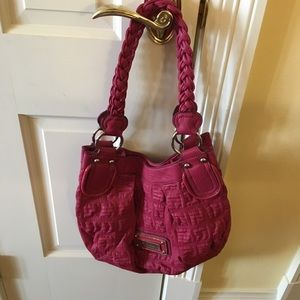 Pink Guess purse. Braided straps. Small chip.